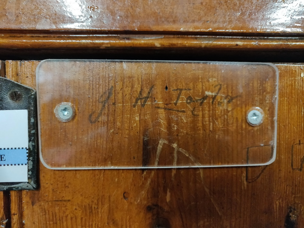 JH Taylor's signature in pencil protected on his locker in the locker room